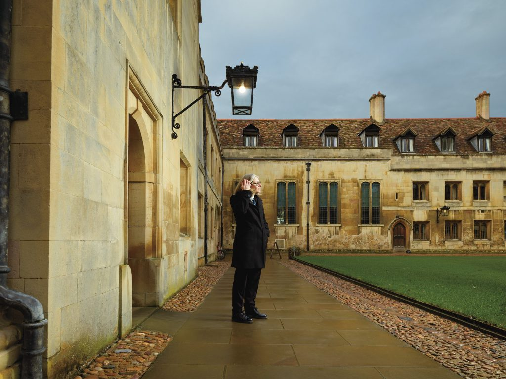 Pembroke porter Sarah Hendry in Old Court at the College