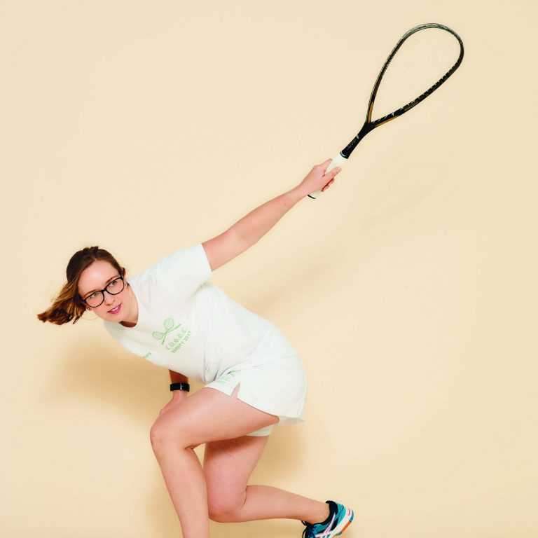 Student playing squash