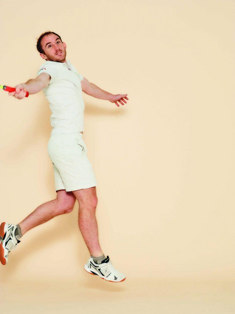 Student playing squash