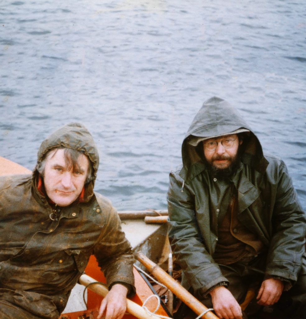 Ted Hughes afloat with Barrie Cooke, pike fishing in Ireland, 1978/9. Image: Aoine Landweer-Cooke