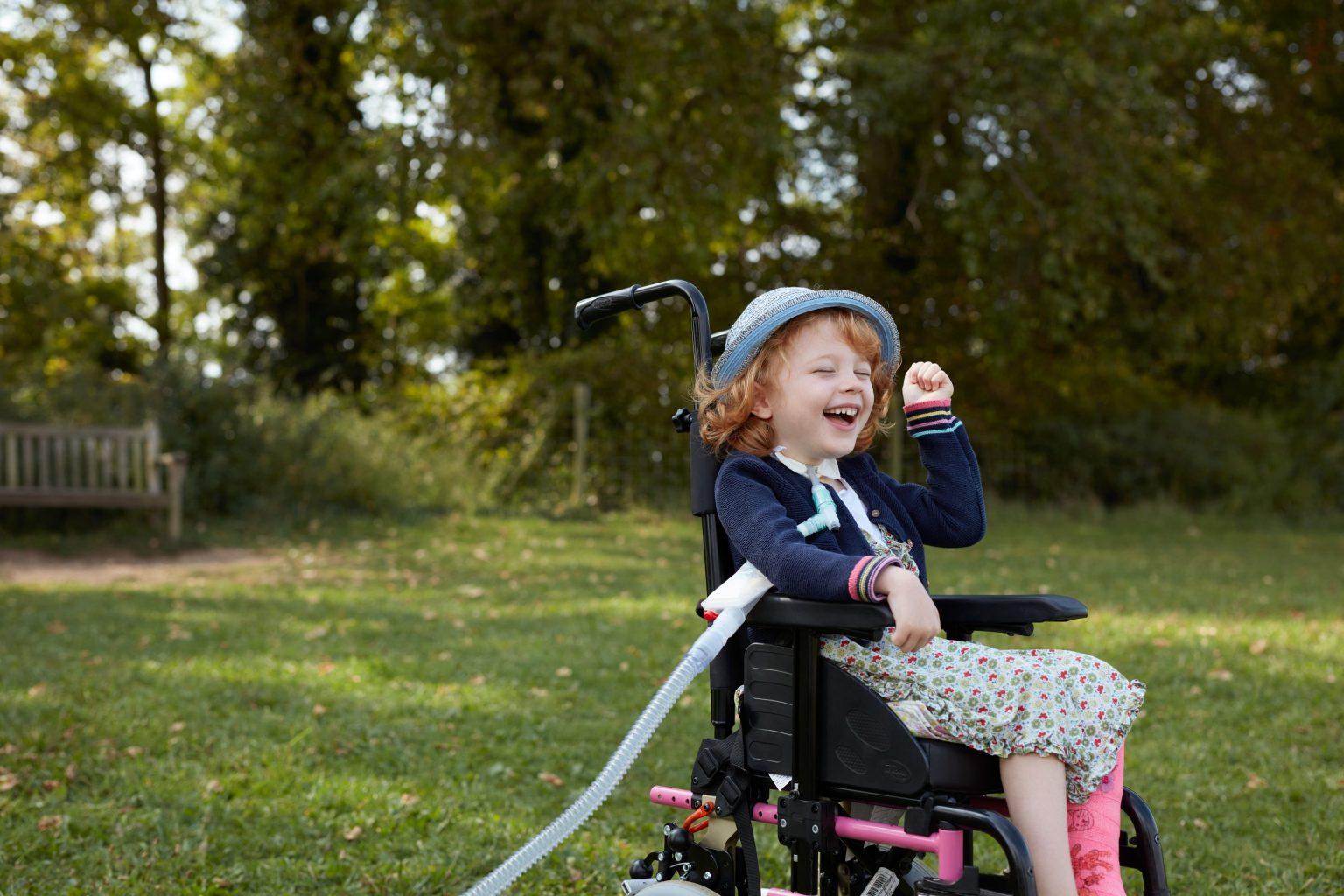 Girl smiling in wheelchair
