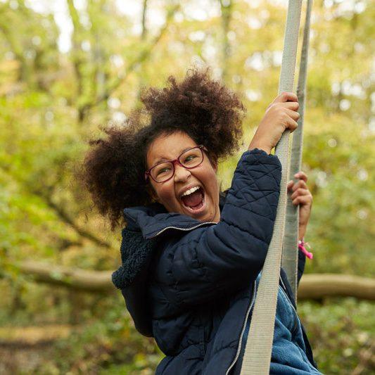 Girl on swing smiling