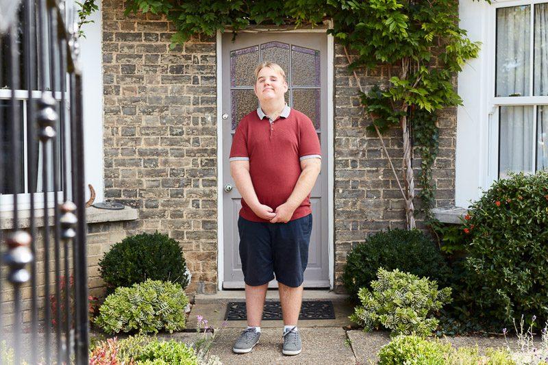 Boy outside house smiling
